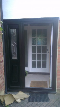 Brown door needed to be painted in black