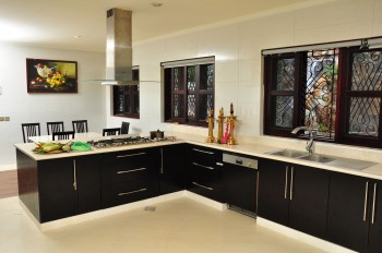 Black Engineered timber veneer kitchen units in black after repair